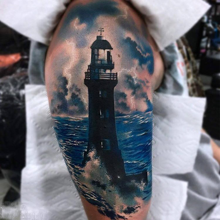 69e6409bd Realistic Blue Water And Lighthouse Tattoo On Sleeve