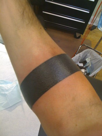 Attractive Solid Band Tattoo On Forearm