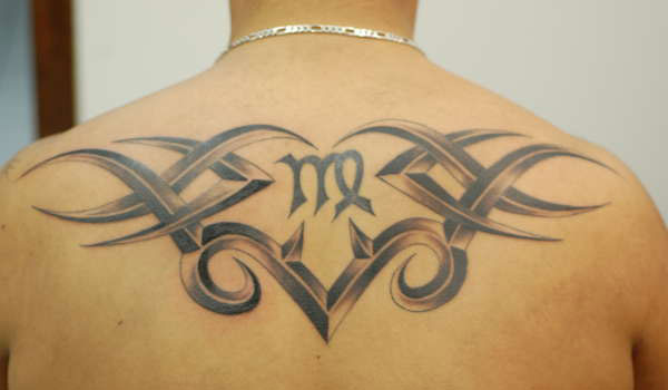 15 famous virgo tribal tattoos for Virgo tribal tattoo
