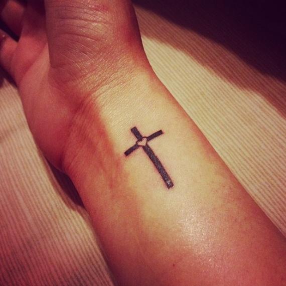 d40f92b46aa97 Black Simple Christian Cross Tattoo On Wrist