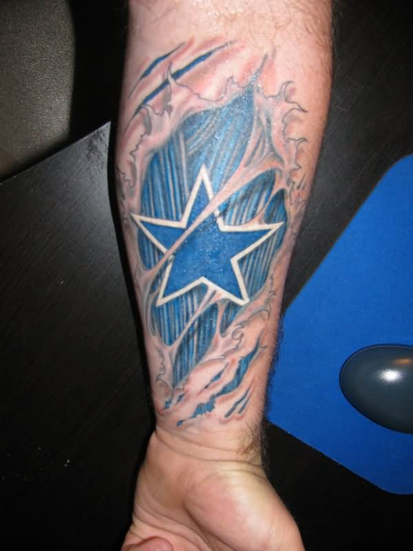 Blue ink ripped skin cowboy star tattoo on forearm for Blue star tattoo