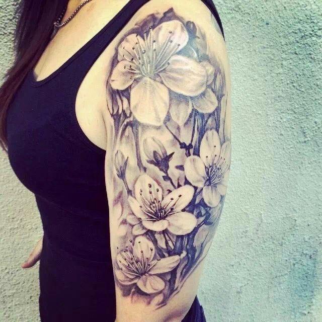 Black And Grey 3D Daisy Flowers Tattoo On Girl Left Half Sleeve