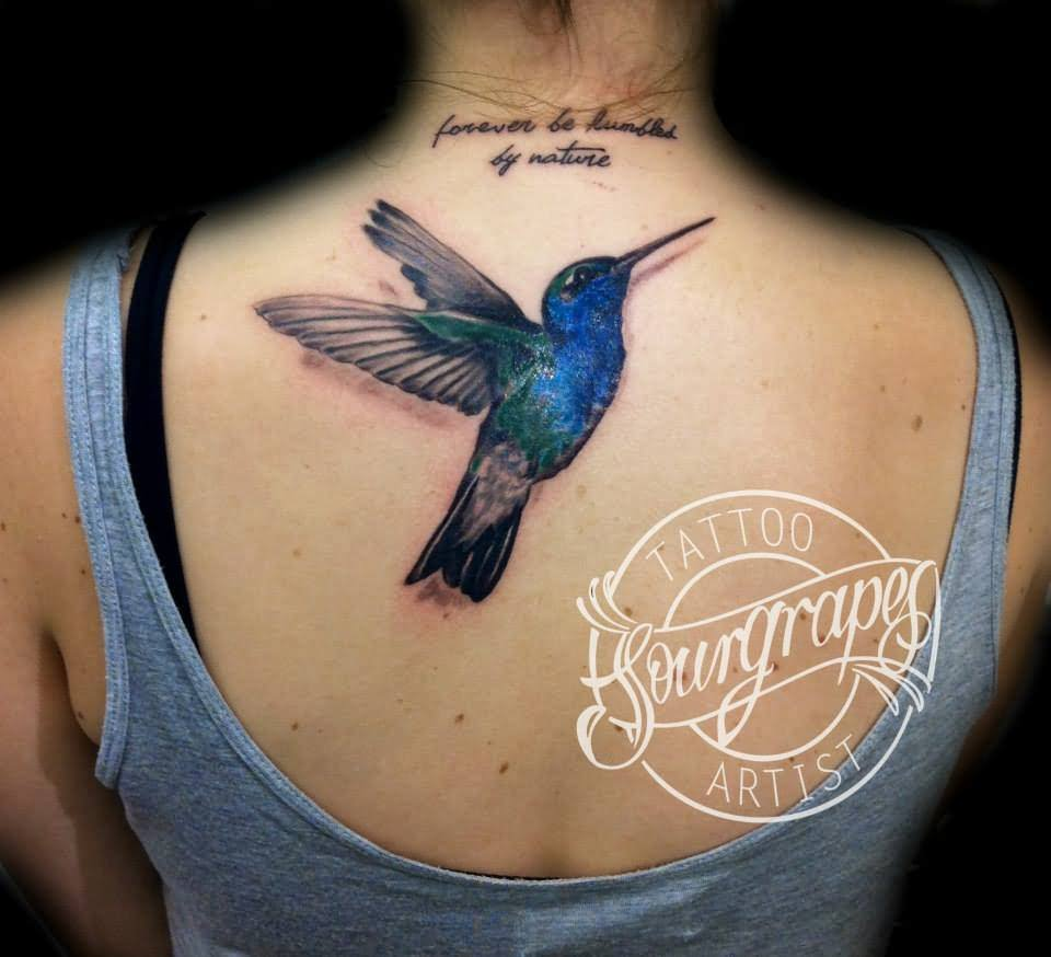Black Outline Flying hummingbird Tattoo On Behind The Ear