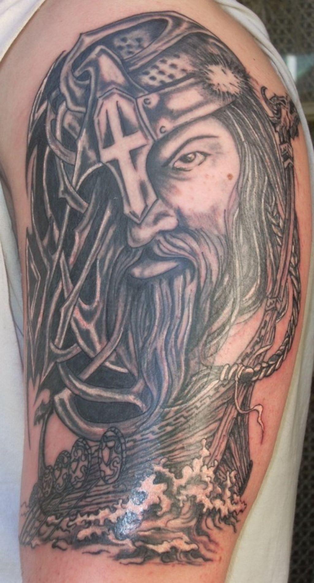 Black And Grey Viking Head Tattoo On Half Sleeve