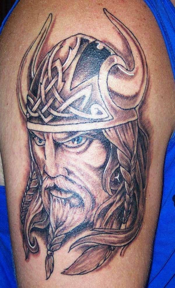 Grey Ink Viking Head Tattoo On Left Half Sleeve