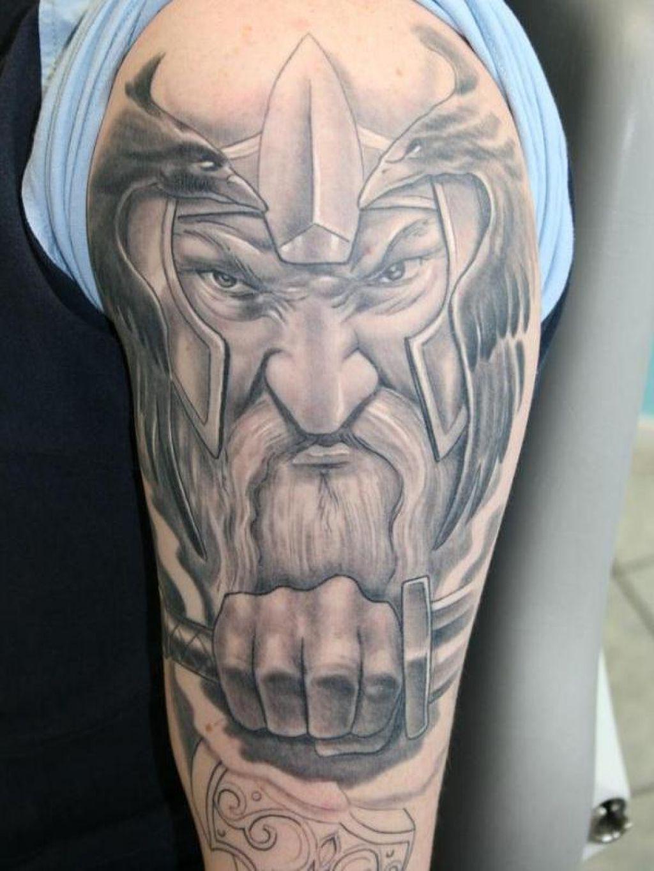 Realistic Grey Viking Tattoo On Man Left Half Sleeve