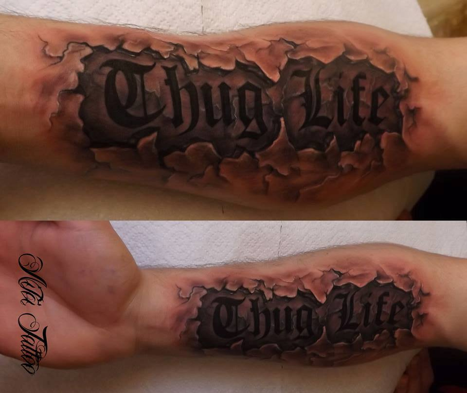 Ripped Skin Thug Life Lettering Tattoo On Forearm