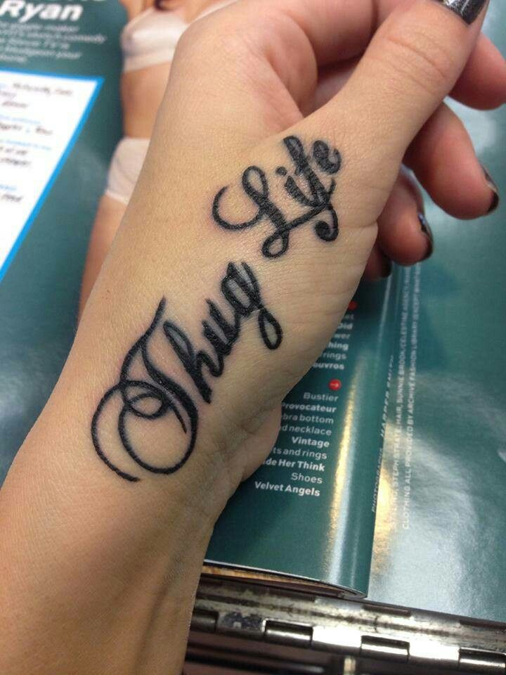 classic thug life lettering tattoo on girl both hand fingers