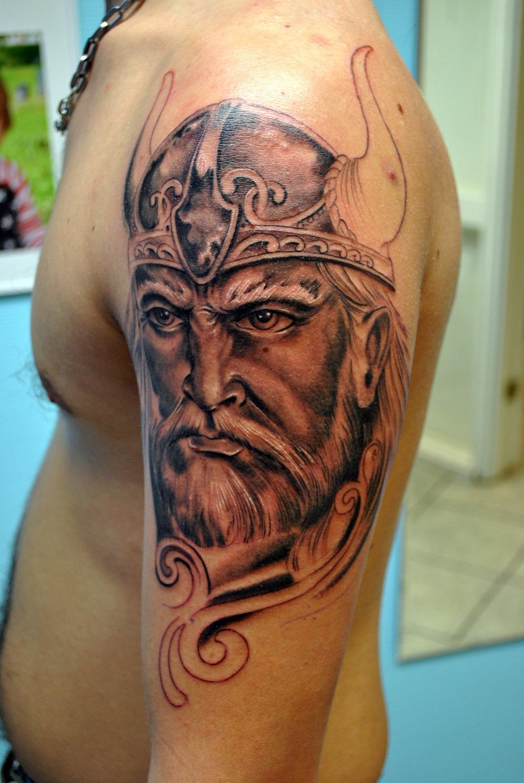 Viking Head Tattoo On Left Half Sleeve