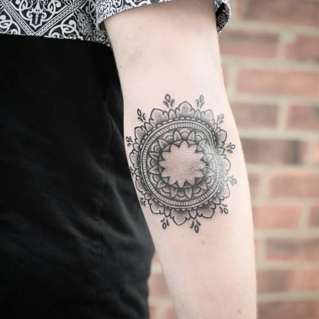 Black And Grey Mandala Flowers Tattoo On Elbow