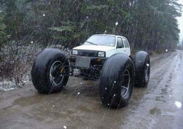 Small Car With Giant Wheels Funny Picture