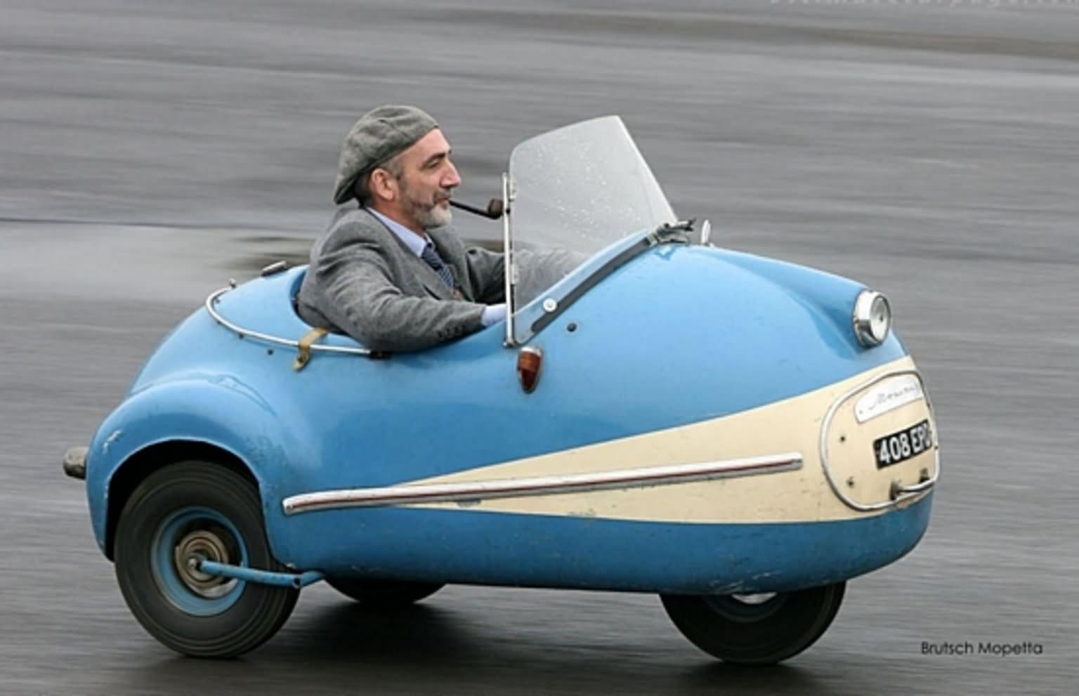 Three Wheels Funny Looking Small Car Photo