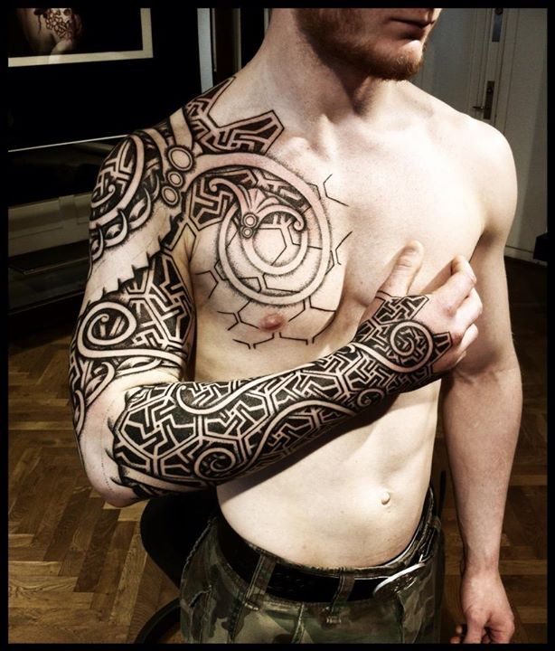 Viking tattoo on man chest and full sleeve for Chest mural tattoos