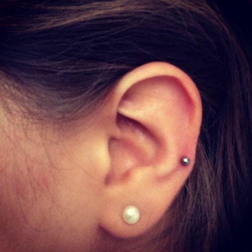 Auricle Piercing On Man Left Ear