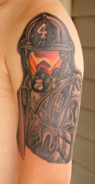 9103fd435 Black And Grey Firefighter Mask With Ribbon Tattoo On Left Half Sleeve.  Awesome Firefighter Tattoo On Left Half Sleeve