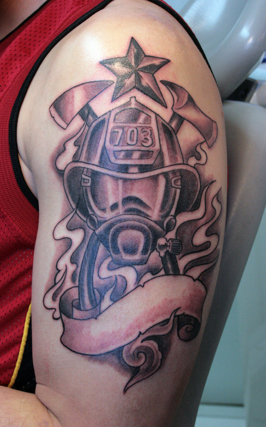 0669addb0 Black And Grey Firefighter Mask With Ribbon Tattoo On Left Half Sleeve