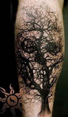 Black Halloween Tree With Skull Tattoo Design For Leg