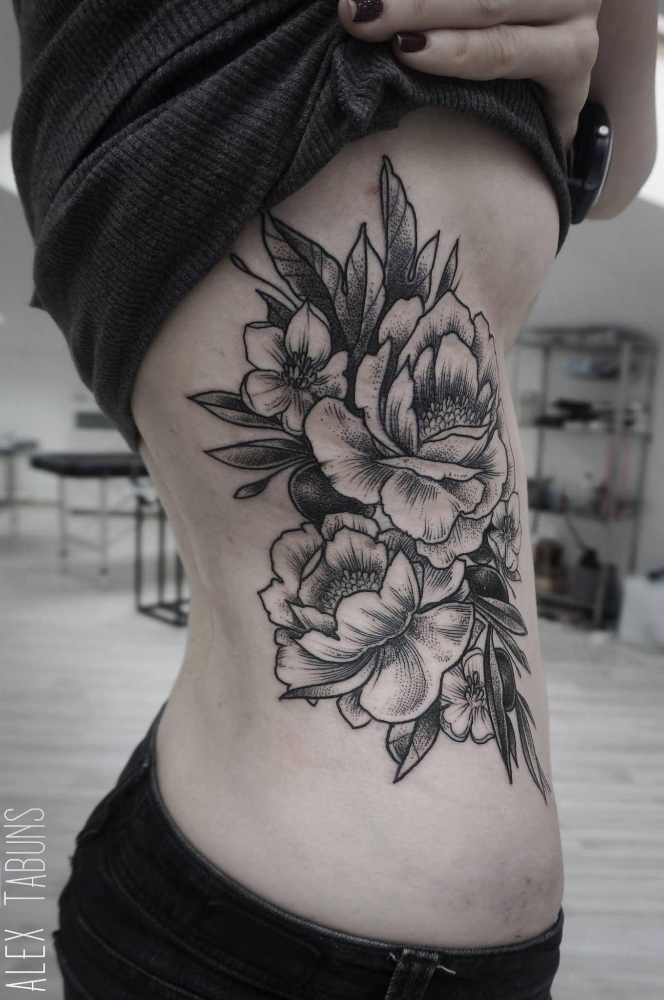 6 floral tattoos on side rib. Black Bedroom Furniture Sets. Home Design Ideas