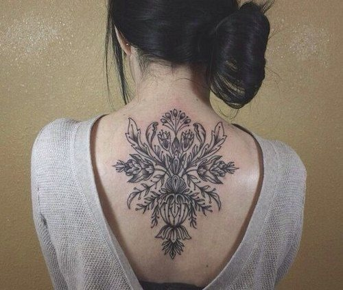 Black Ink Floral Tattoo On Girl Upper Back