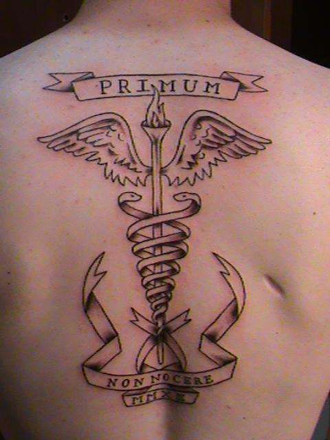6 medical symbol upper back tattoos for Non ducor duco tattoos designs