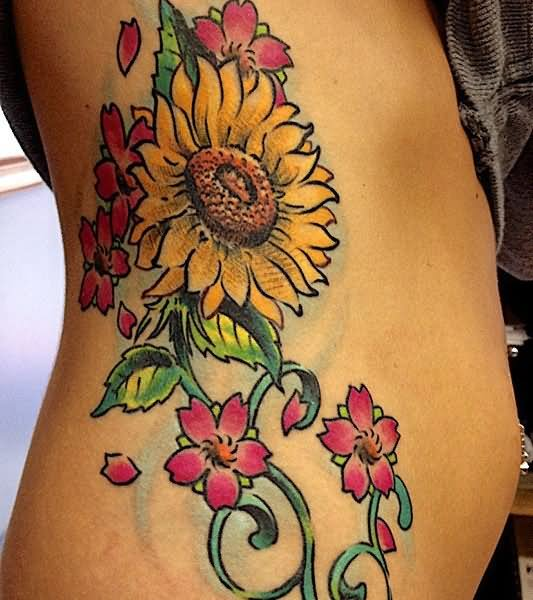 colorful floral tattoo design for side rib. Black Bedroom Furniture Sets. Home Design Ideas