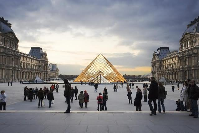 Crowded At The Louvre Museum At Sunset