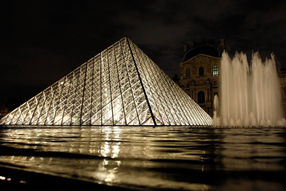 Glass Pyramid And Fountain At The Louvre Museum