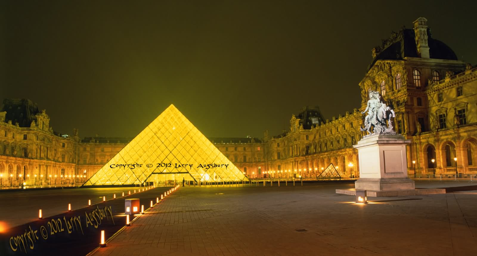 Lighting Decoration At Glass Pyramid And The Louvre Museum