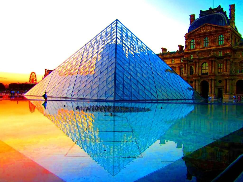 The Louvre Glass Pyramid At Sunset
