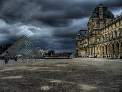 The Louvre Museum With Glass Pyramid Looks Cool With Black Clouds