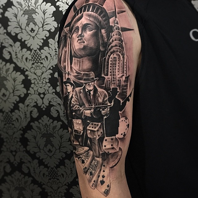 Gangster With Cubes And Statue Of Liberty Tattoo On Right Half Sleeve