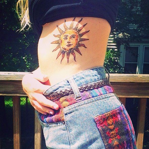 Attractive Sun Tattoo Design For Side Rib