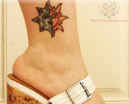 Awesome Hippie Sun Tattoo On Girl Leg