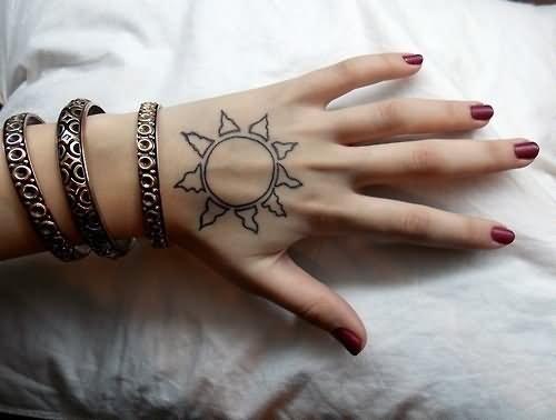 Black Outline Hippie Sun Tattoo On Girl Hand