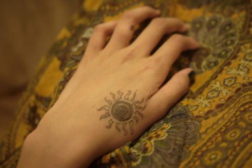 Classic Hippie Sun Tattoo On Hand