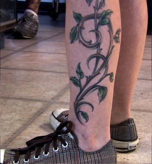 708740258 Cool Leaves Vine Tattoo On Man Left Leg