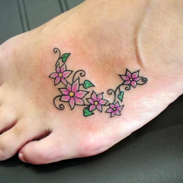 Black ink grape vine tattoo on foot for Flower vine tattoo images
