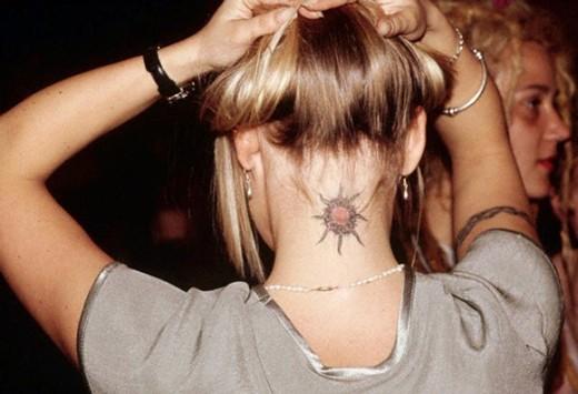 Hippie Sun Tattoo On Girl Back Neck