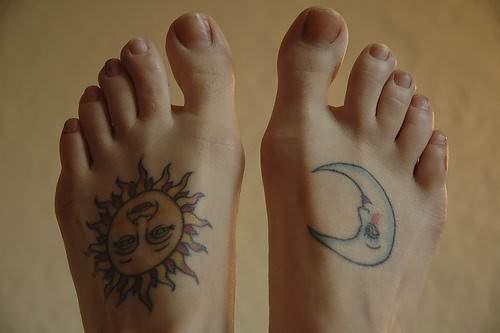 Simple Hippie Sun With Half Moon Tattoo On Feet