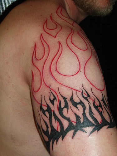 Black and red fire and flame tattoo on right shoulder for Black and white flame tattoo