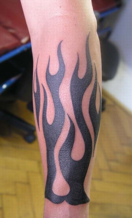 black tribal flame tattoo on arm sleeve
