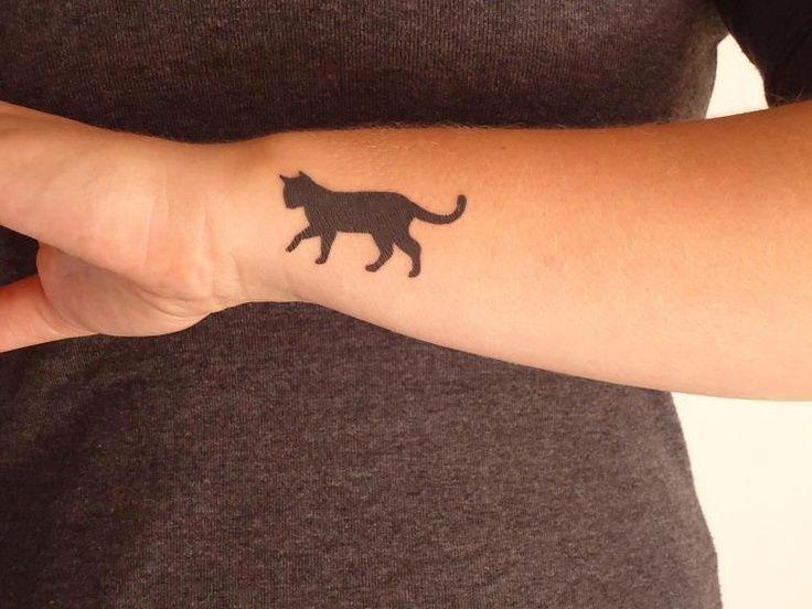 small cat silhouette tattoo on girl side wrist rh askideas com Female Wrist Tattoos Cute Sayings Roman Wrist Tattoo Quotes