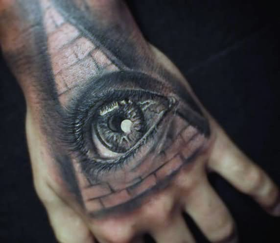 black and grey eye with pyramid tattoo on hand. Black Bedroom Furniture Sets. Home Design Ideas
