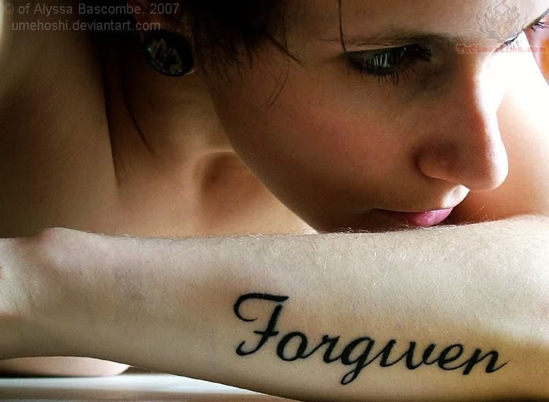 Black forgiven word tattoo on girl forearm for Tattoos with hidden words