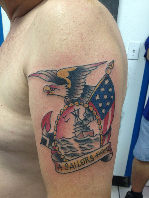 Flying eagle country tattoo on left bicep for Country tattoo ideas