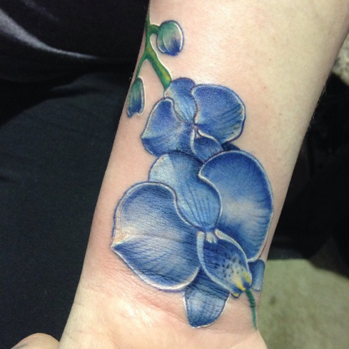 65a0223c465a6 Awesome Blue Orchid Tattoo On Wrist