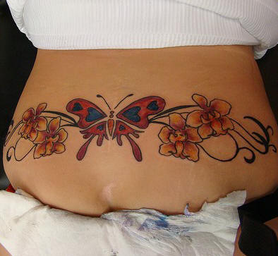 colorful blue and pink orchid flowers tattoo on side rib. Black Bedroom Furniture Sets. Home Design Ideas