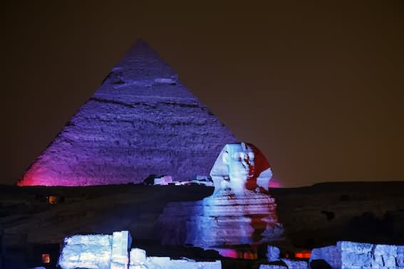 Colorful Lights On The Egyptian Pyramid And Sphinx At Night