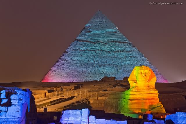 Egyptian Pyramid And Sphinx Lit Up At Night