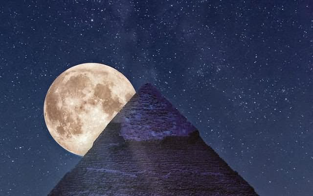 Full Moon Just Behind The Egyptian Pyramid At Night